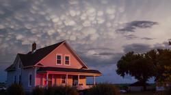 Wolken kijken: mammatus: Ronde hangende bobbelwolken