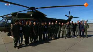 Ambassadeurs verzamelen voor de helikopter