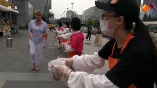 Zomercolumn: gratis rijstebrij voor forenzen in Peking