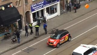 Man met Palestijnse vlag slaat ruiten koosjer restaurant in Amsterdam in