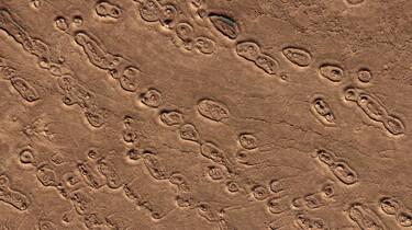 Hoe ziet Mars eruit van dichtbij?: Kraters, lava en zandduinen