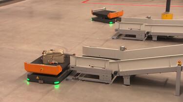 Hoe werkt een bagagerobot?: Jouw koffer van incheckbalie tot vliegtuig