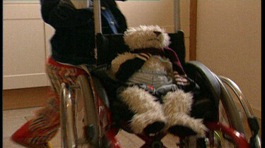 In een rolstoel