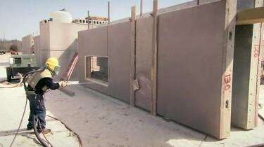 Hoe wordt een voorgegoten betondwand gemaakt?