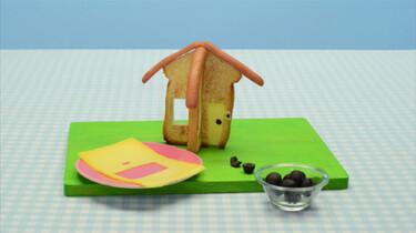 Een huisje van brood en knakworst